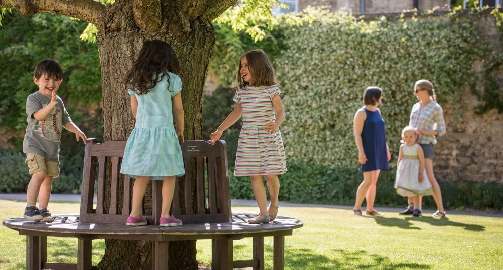 Children play around a tree in the Green Templeton gardens