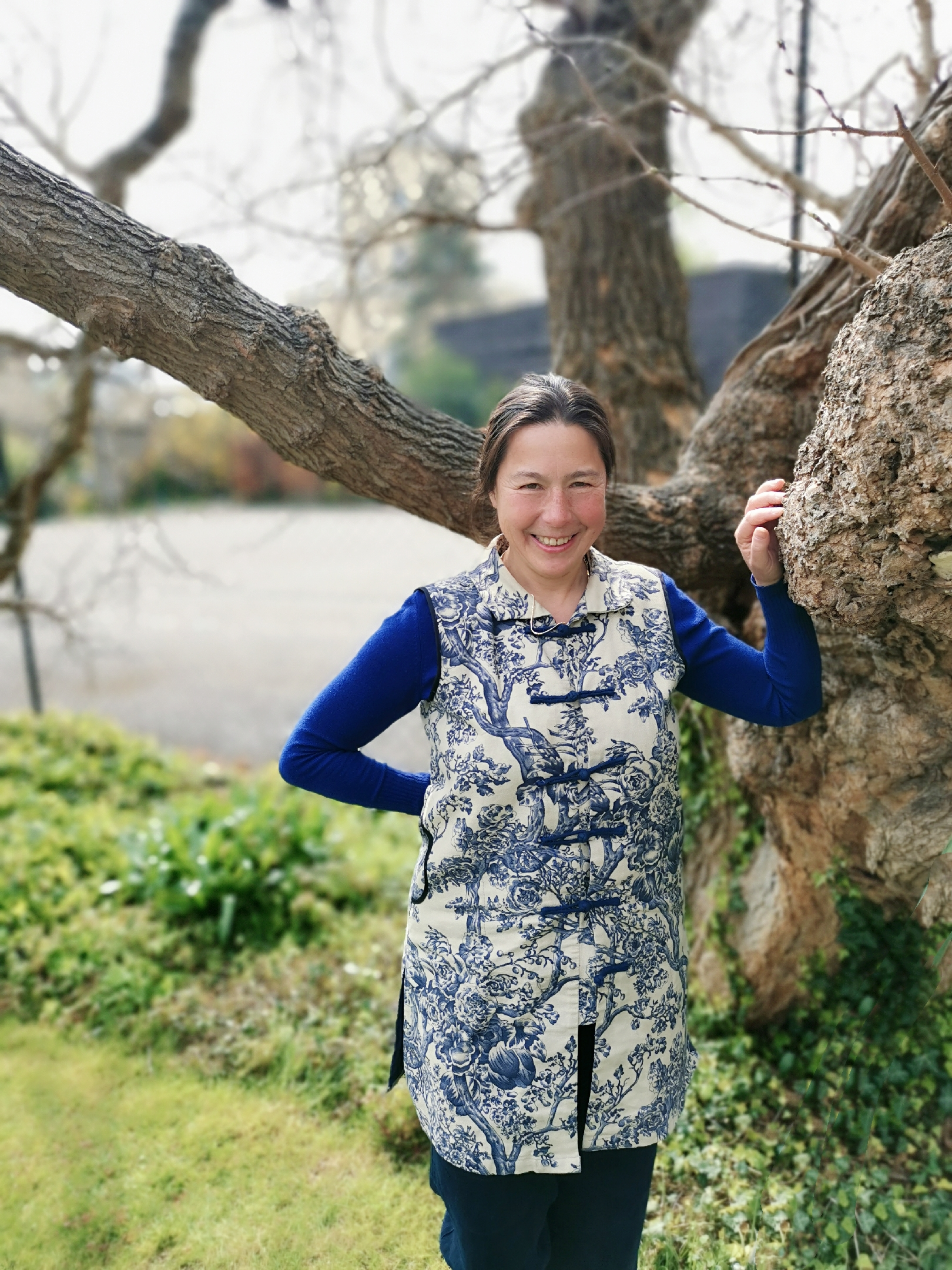 Professor Elisabeth Hsu smiling as she leans against a mulberry tree