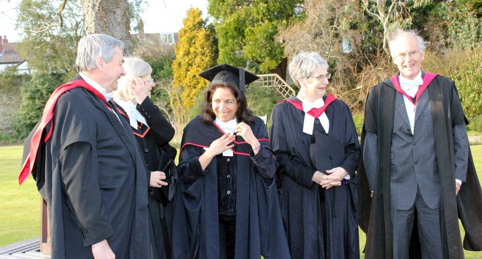 College members wear the traditional black sub fusc robes of Oxford