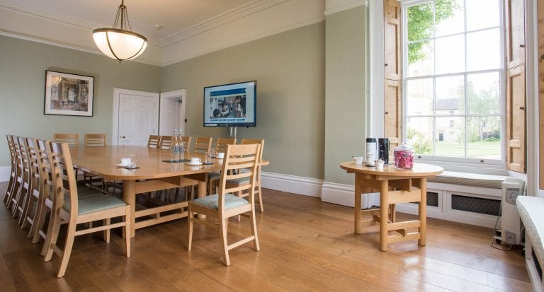 A long conference table and 13 chairs in the Kawasaki Room at Green Templeton College