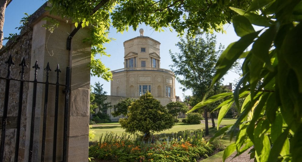 The Radcliffe Observatory seen through a leaf-covered archway