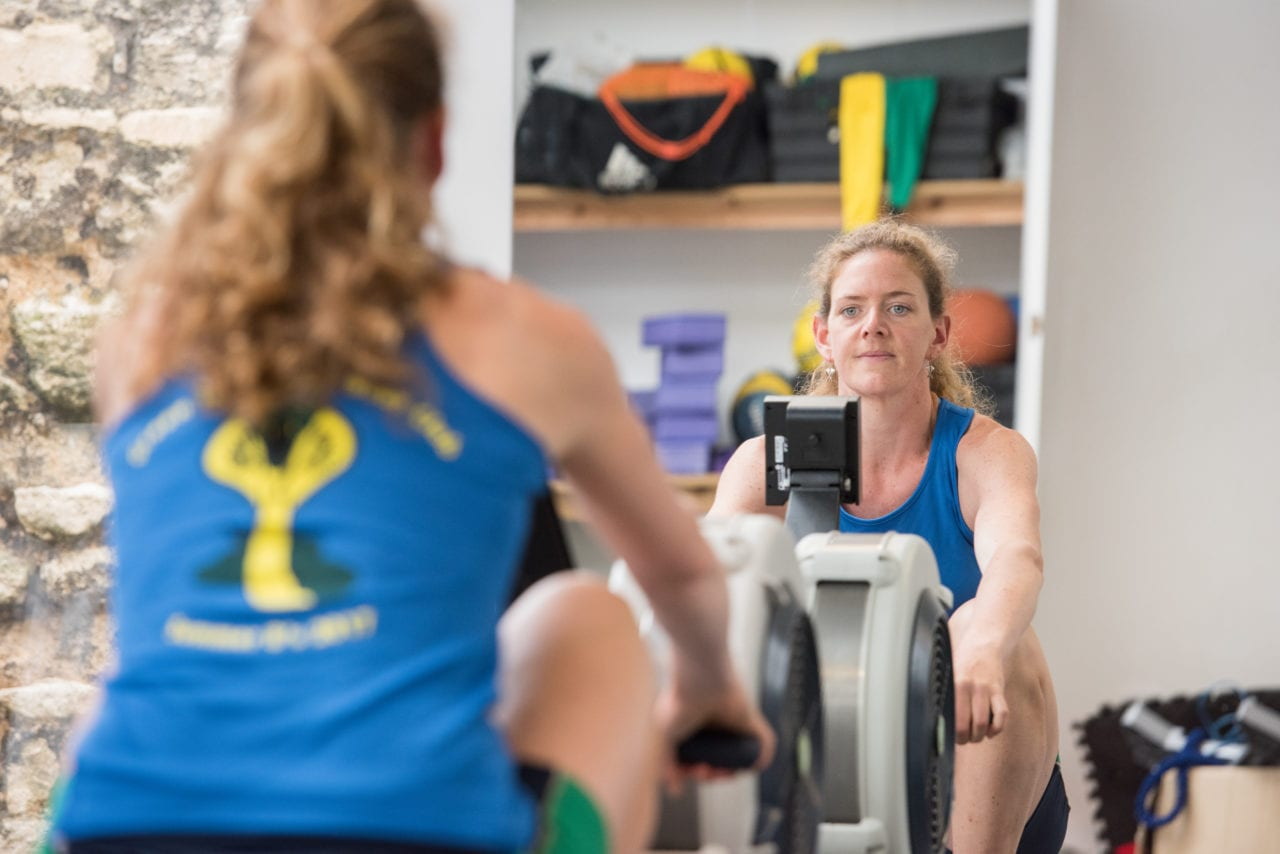 Green Templeton College student rowing in on-site gym. Photo (c) John Cairns
