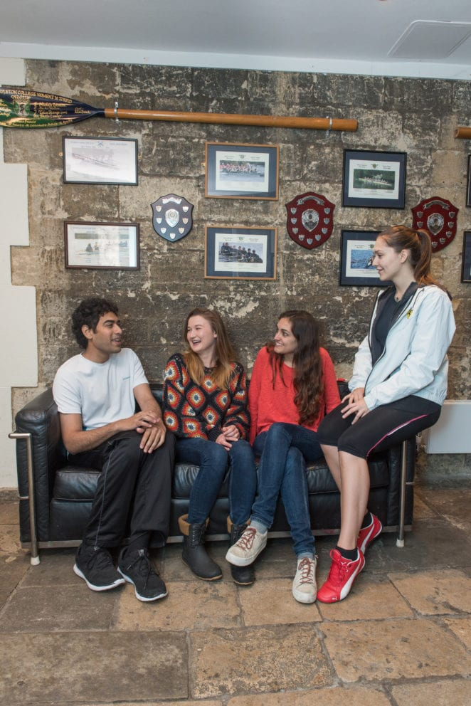 Green Templeton College 10 anniversary. Students talking in the Stables Gallery. Photo (c) John Cairns