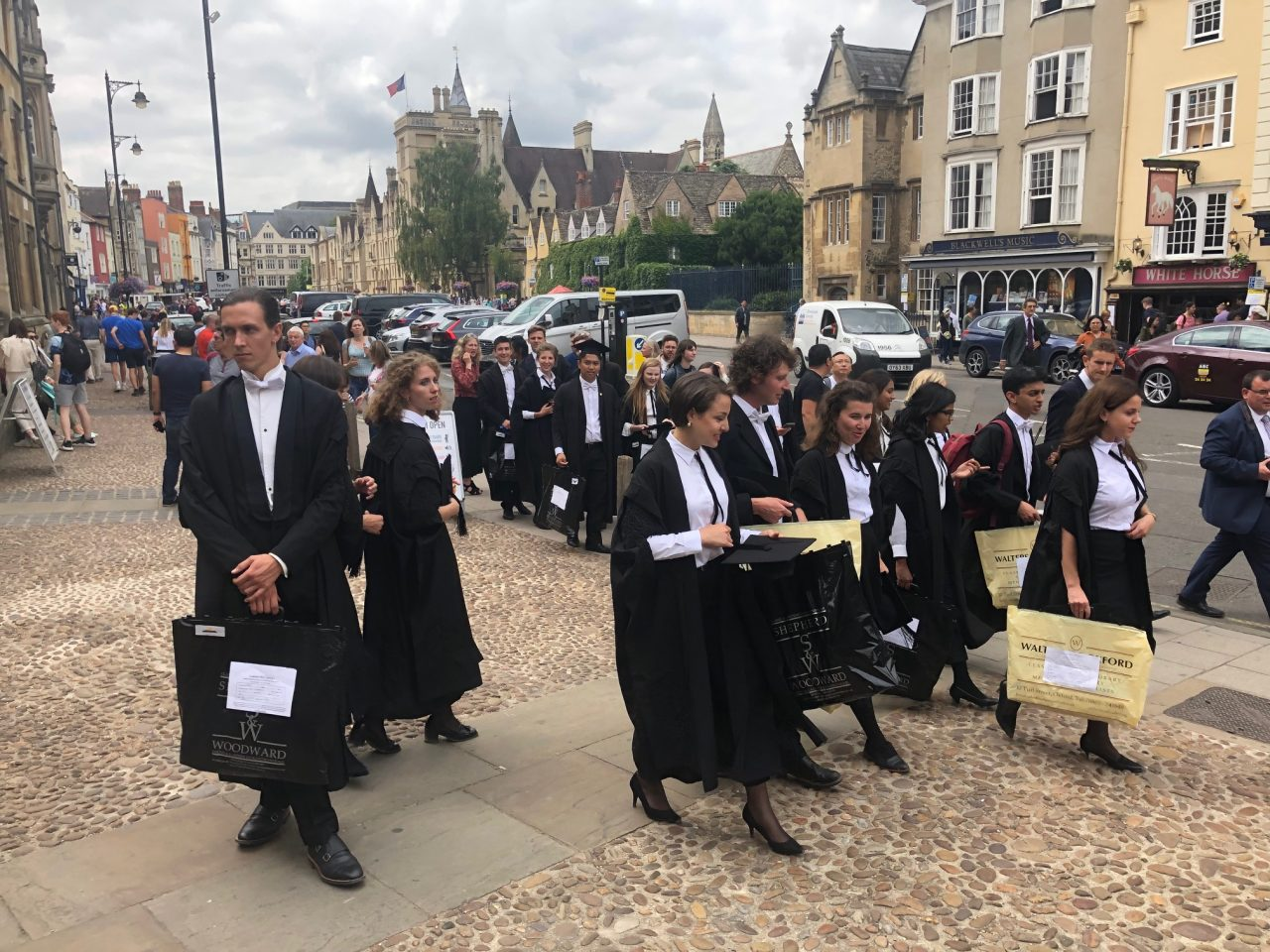 BM students gather outside the Sheldonian ahead of their graduation.