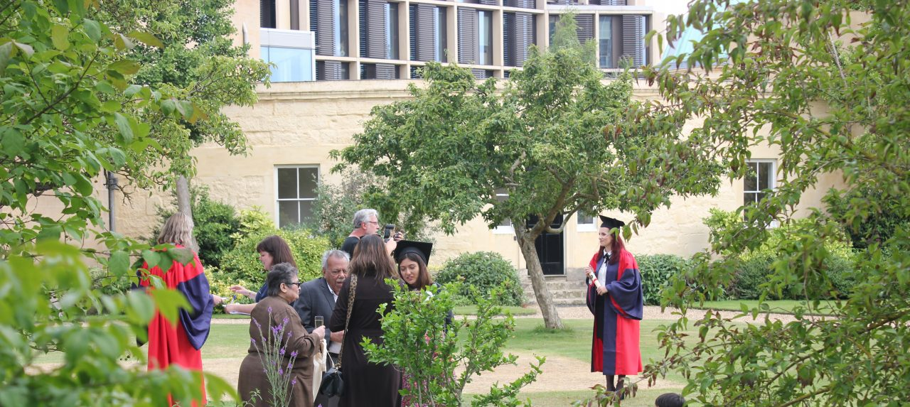 New graduates have their photographs taken in the gardens outside the Radcliffe Observatory at Green Templeton College.