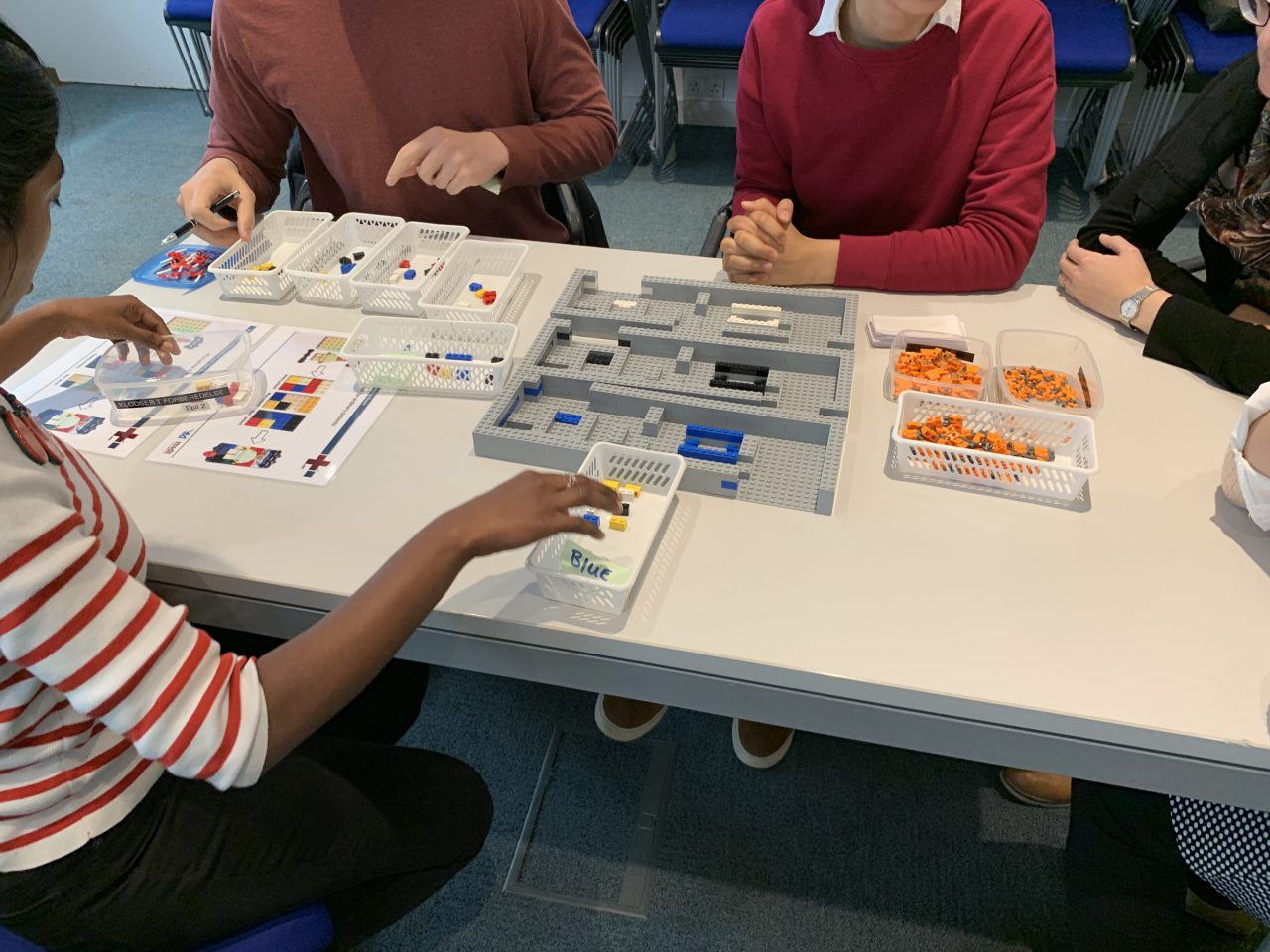 Participants using LEGO during a Management in Medicine, BRICK HOSPITAL workshop in May 2019