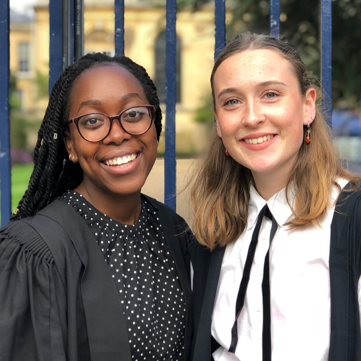 Claire Otasowie and Ellie Hopkinson in sub fusc smiling on matriculation day