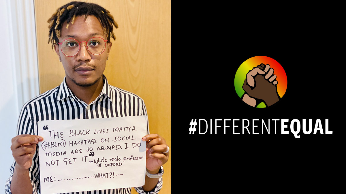 Student Tonny Muthee holds a sign supporting the #DIFFERENTEQUAL campaign